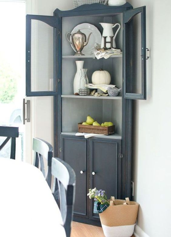 a stylish vintage graphite grey storage cabinet with open shelves and a closed storage space too