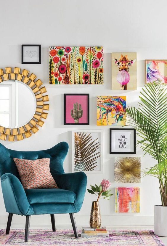 a super bright nook with a modern navy wingback chair, a mirror, a bright gallery wall and a potted plant