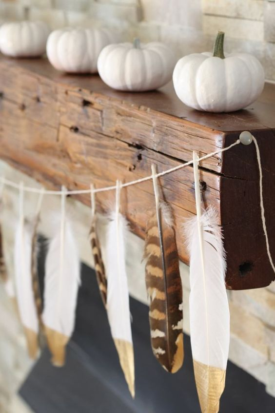 skip usual skull and candy corn buntings and go for a dipped feather garland for a boho feel in your space