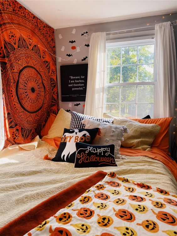 a Halloween-ready bedroom with a bright mandala on the wall, bright Halloween bedding and pillows