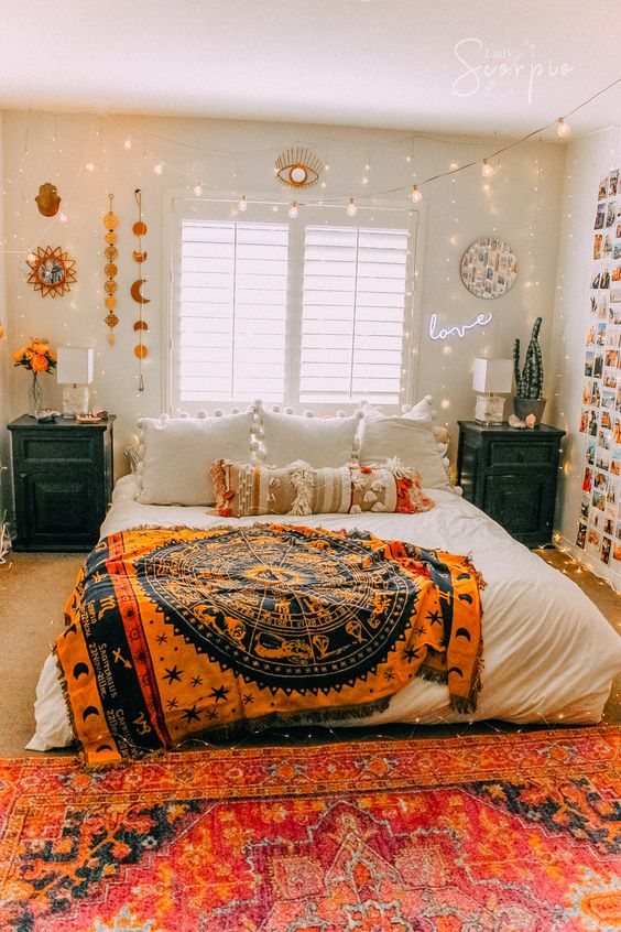 a bright Halloween bedroom with a tarot blanket, cool wall hanging and an eye light over the window