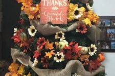 a bright Thanksgiving tree with burlap ribbons, faux blooms, leaves, pumpkins and a sign is a very cool idea