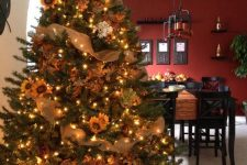 a fall tree decorated with lights, leaves, sunflowers, burlap ribbons is a nice rustic decoration for Thanksgiving