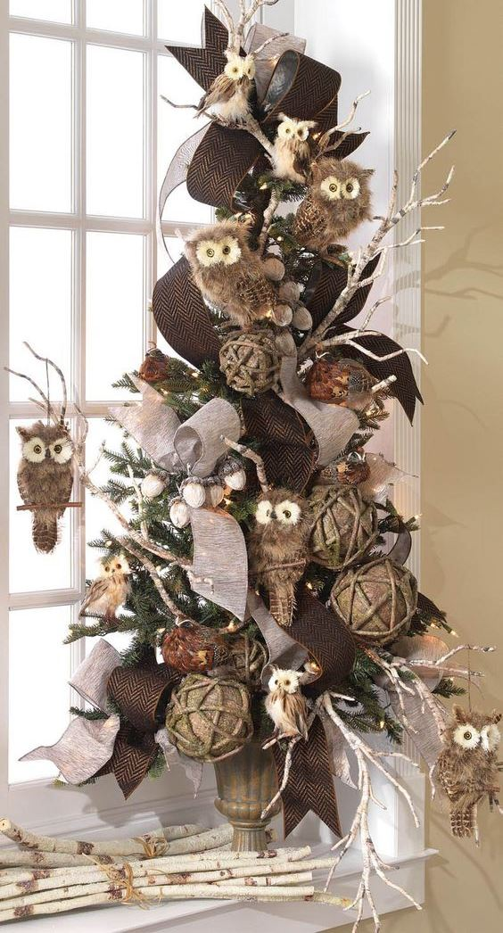 a fall tree with twine blls, brown ribbons, owls, acorns and branches plus some lights can be a fit for Thanksgving