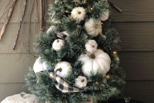 a mini fall tree with white pumpkins, lights and a plaid ribbon is a stylish decoration for fall or Thanksgiving