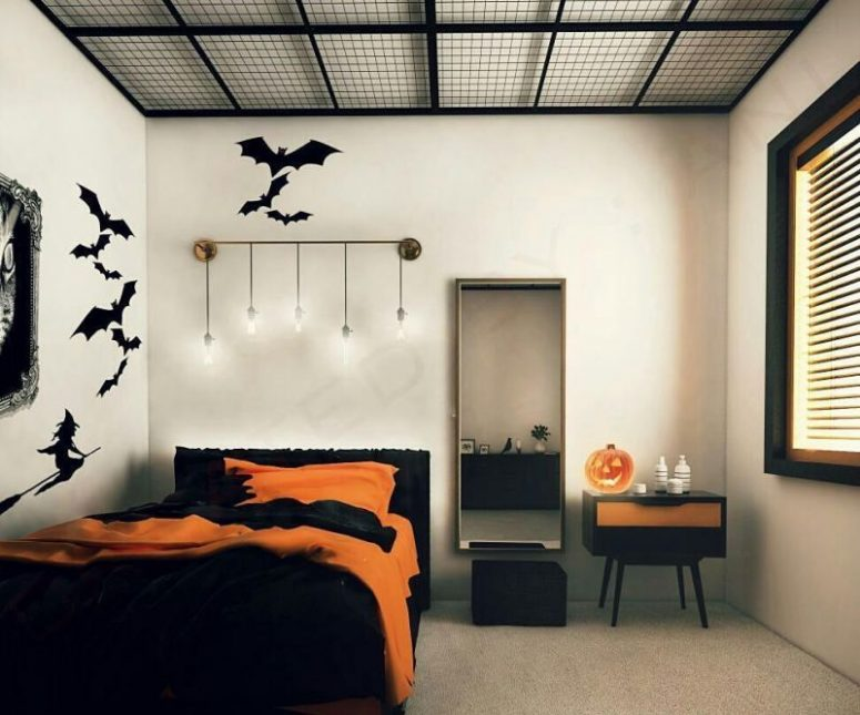a minimalist Halloween bedroom with black bat stickers, black and orange bedding and a matching cabinet plus a jack-o-lantern