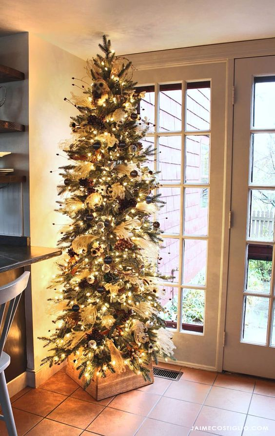 a stylish Thanksgiving tree with lights, pinecones, black chalkboard ornaments, white ornaments and owls