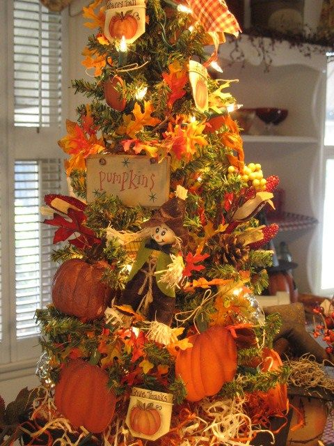a vintage-inspired fall tree with lights, faux leaves, paper pumpkins, pinecones, berries and plaid decor