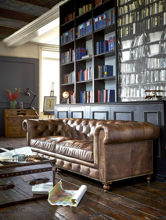 an elegant moody home office with a brown leather Chesterfield sofa that is a centerpiece here