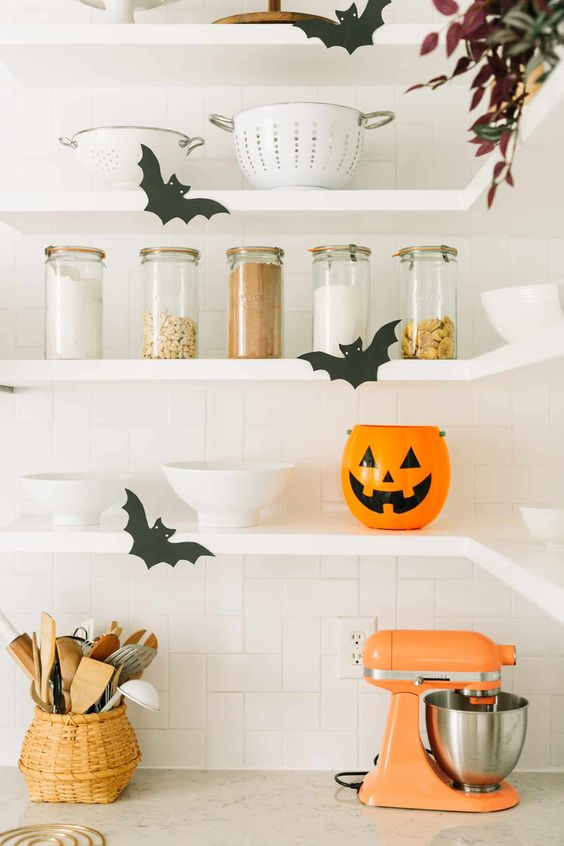 black paper bats and a Halloween planter will make your kitchen look like Halloween but minimalist-like