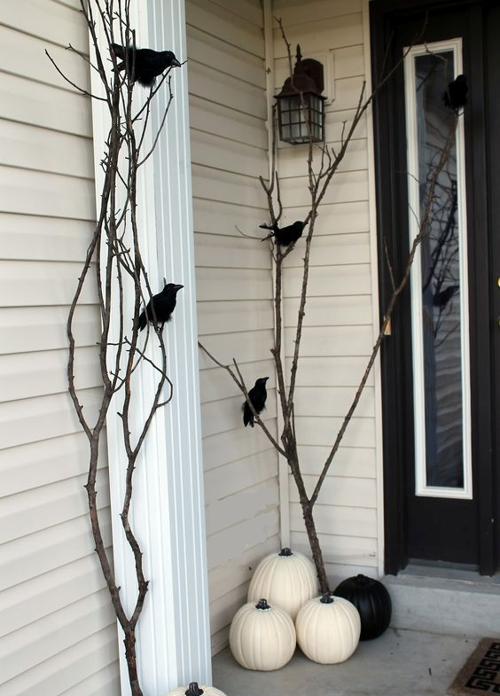 branches with crows and black and white pumpkins will make your porch minimalist and Halloween-like