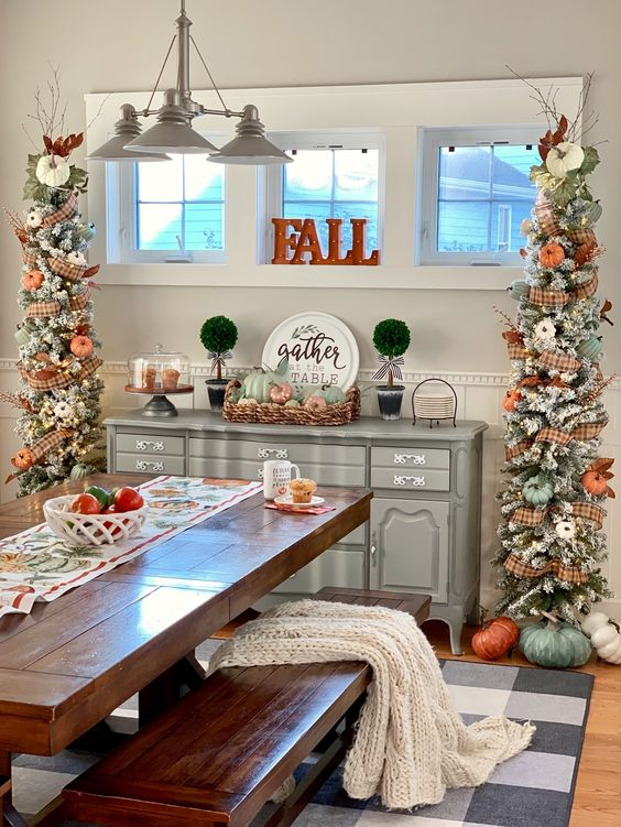 chic snowy Thanksgiving trees with plaid ribbons, white and orange pumpkins, leaves, branches and lights