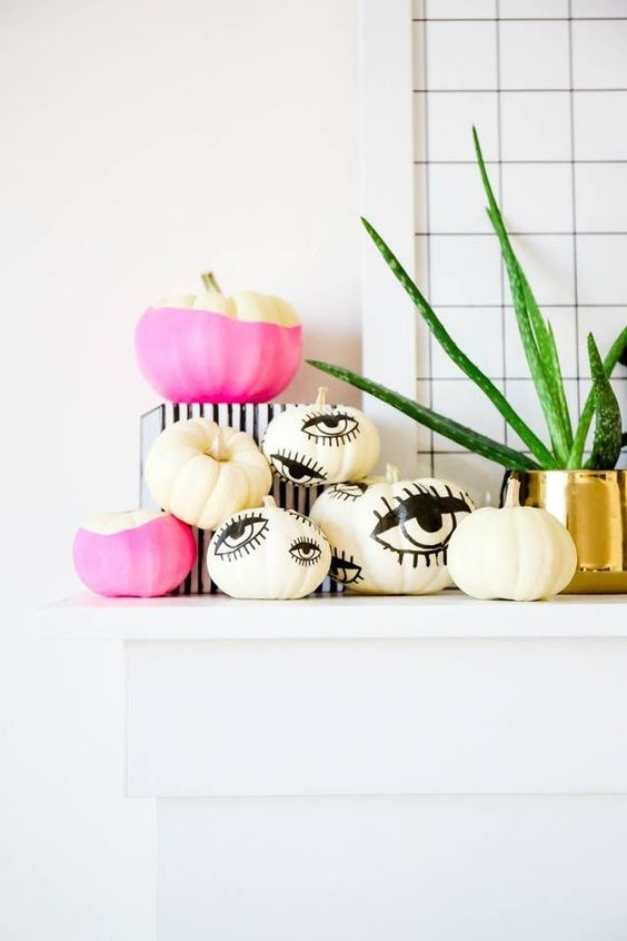 classy Halloween mantel decor with eyed and color block pumpkins is a timeless and chic minimalist idea