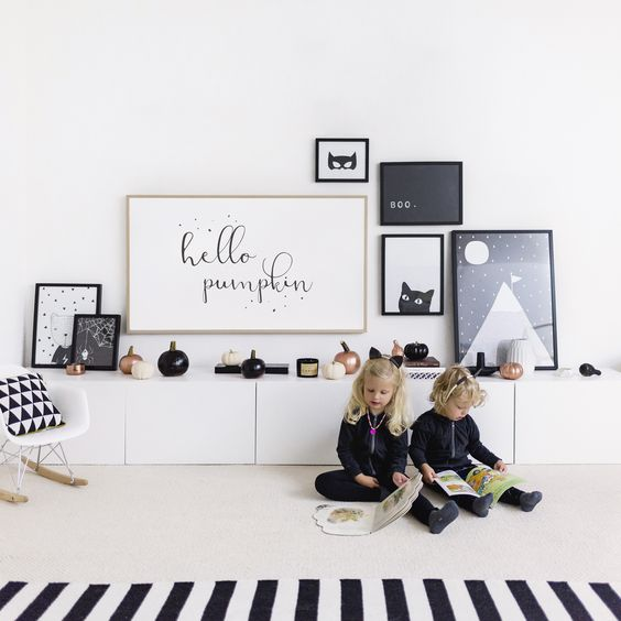 minimalist Halloween styling with copper, black and white pumpkins and a black and white gallery wall
