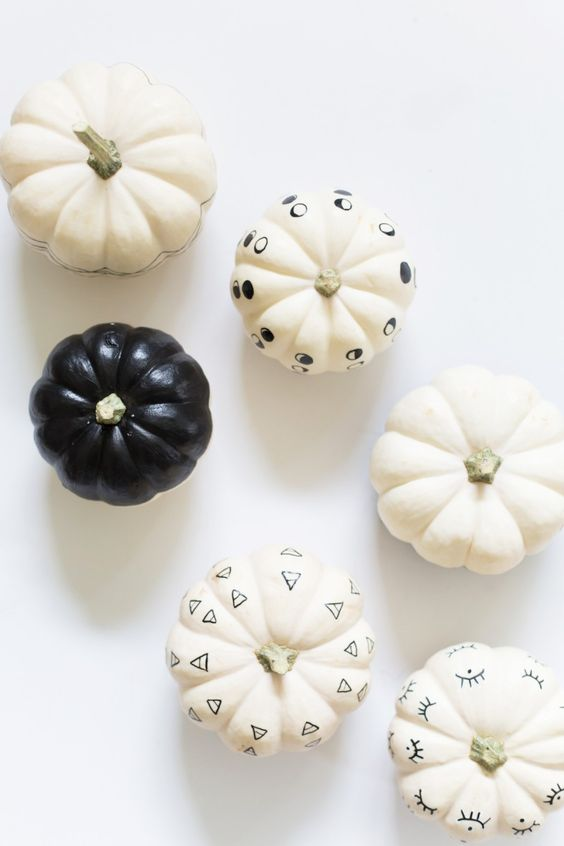 minimalist black and white pumpkins with patterns can be easily create using some paint and a sharpie
