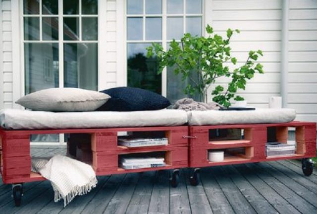 a bright red pallet daybed with storage space and casters is an ideal piece for both indoors and outdoors