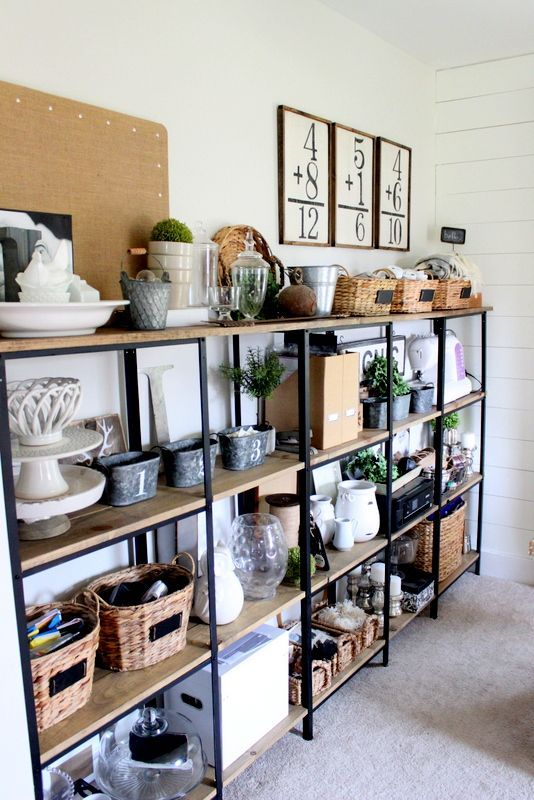 a custom industrial meets rustic shelving unit built of Hyllis shelves and wood