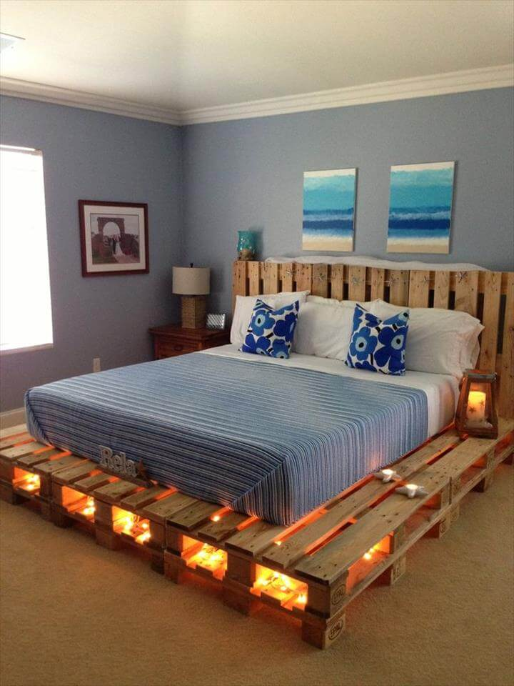 a comfy pallet bed with lights inside allows you to skip lamps on your nightstands