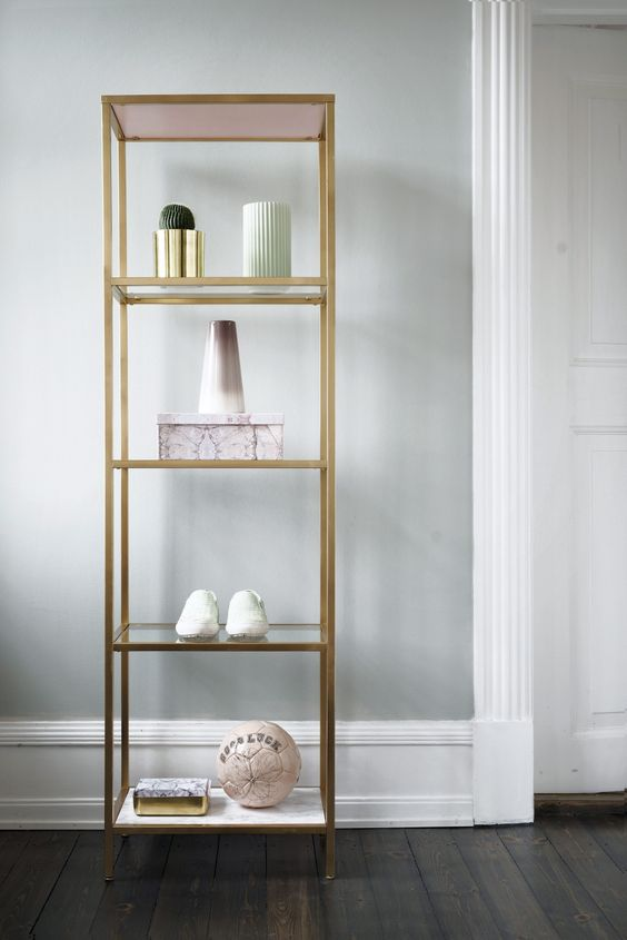a Hyllis shelf done with glass shelves, pink and marble contact paper ones and a gold spray painted frame