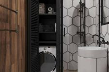 04 a modern monochromatic bathroom with a hidden wahsing machine and storage space next to the shower