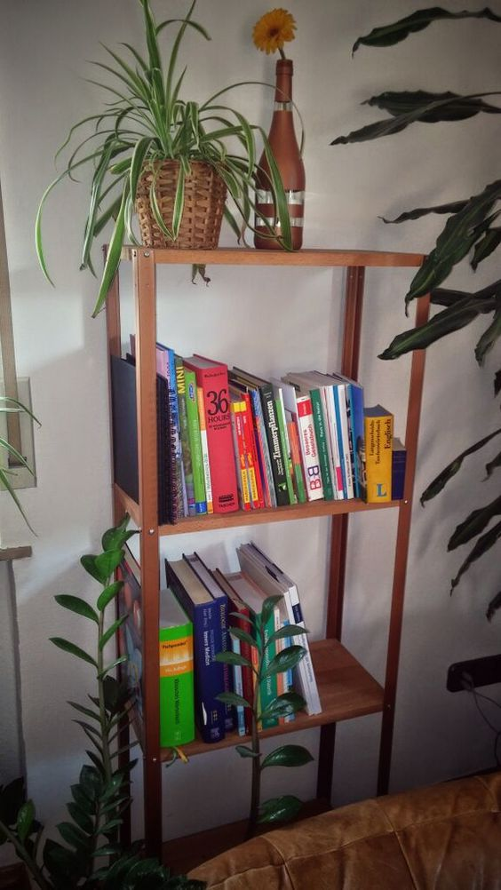 a mid-century modern IKEA Hyllis shelf hack with wooden shelves and copper spray paint