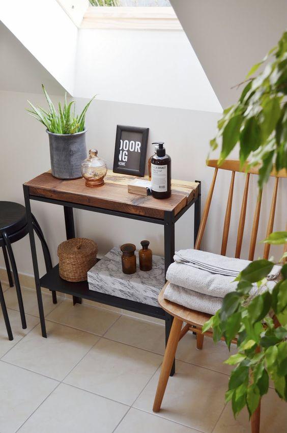 a mini bathroom shelf with a stained wood top made of an IKEA Hyllis shelf