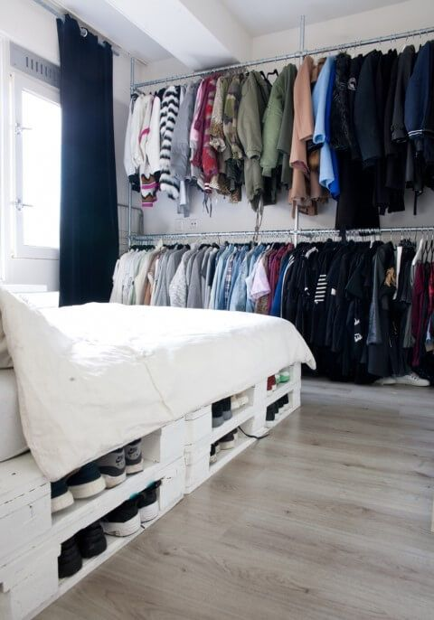 a pallet bed with storage space inside can be used, for example, for storing shoes to save space in the closet