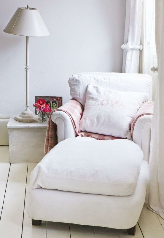 a soft white reading lounger with pillows and a plaid blanket is a stylish unit for reading