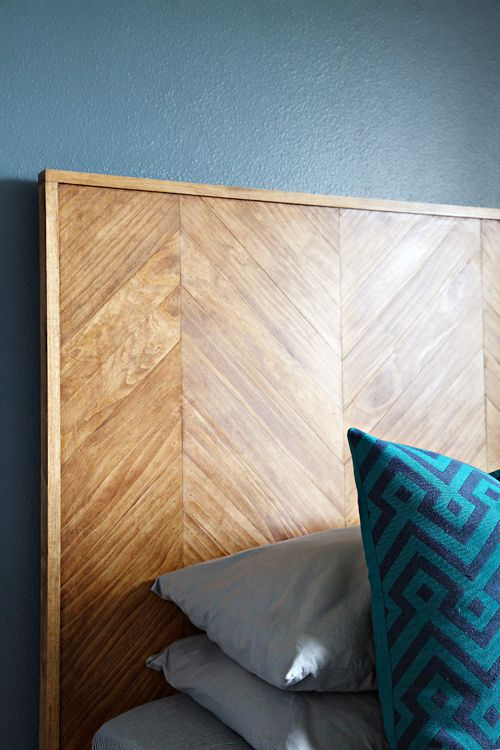a stained herringbone plywood headboard is a stylish way to add some touch of color and pattern to the room
