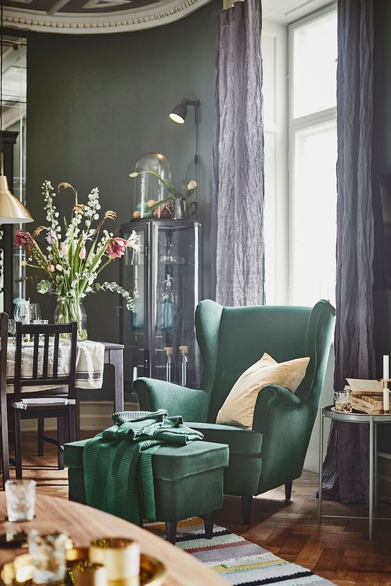 a hunter green wingback chair with a matching footrest or ottoman is a lovely piece to add vintage chic to your reading nook