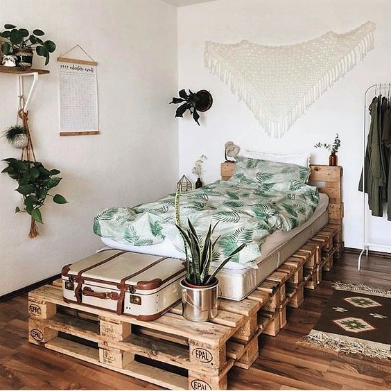 a pallet guest bed with planters and a space for a suitcase is perfect and you can DIY it