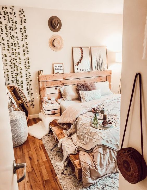 a rustic meets industrial bed built of pallet wood will easily fit a rustic or boho bedroom