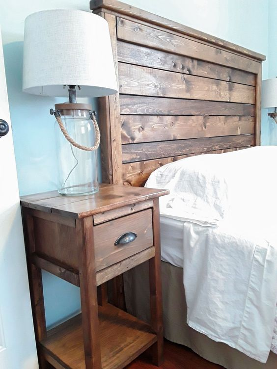 a rich stained wooden headboard and matching nightstands for a rustic feel in the bedroom