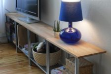 12 a modern and chic TV unit made of an IKEA Hyllis shelf and wood