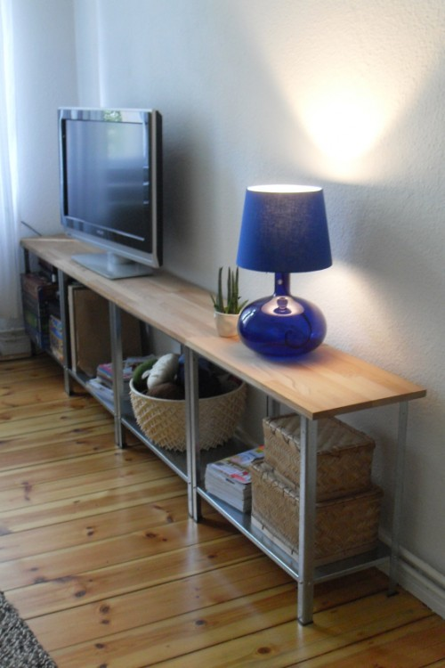 a modern and chic TV unit made of an IKEA Hyllis shelf and wood