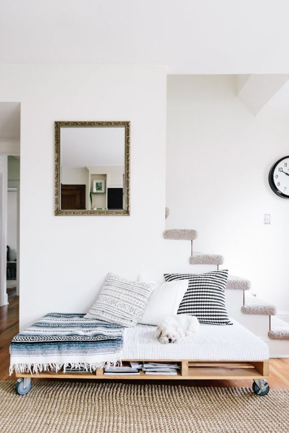 a stylish contemporary pallet daybed on casters with some storage space inside