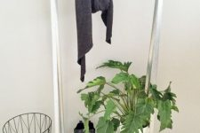 13 an IKEA Hyllis shelf turned into a simple and minimal entryway rack for hanging clothes and storing shoes