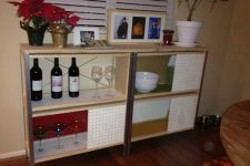 14 a stylish modern credenza built of IKEA Hyllis, APA storage boxes and pegboards