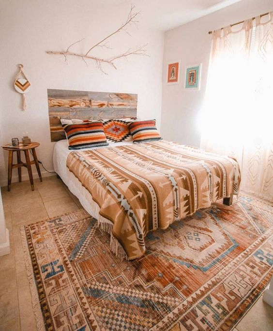 a bright fall boho bedroom with a reclaimed wooden headboard that adds even more coziness to the space