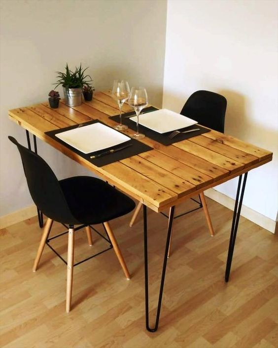 a small and comfy dining table with a pallet tabletop and black hairpin legs will fit even a very small nook
