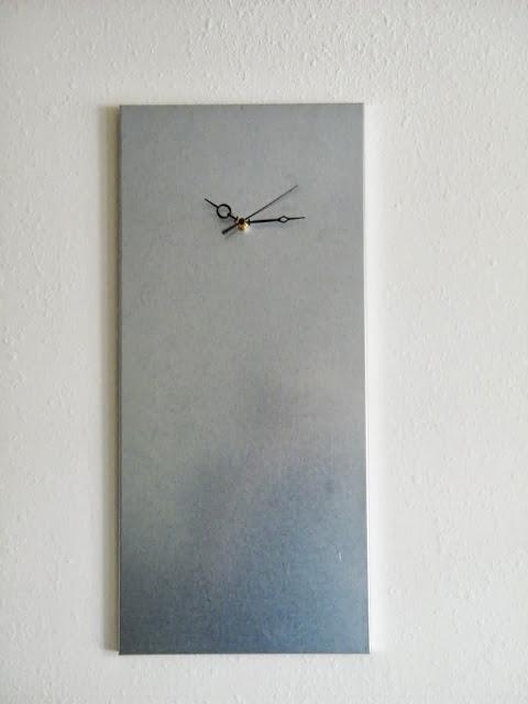 an industrial meets modern clock made of a piece of a Hyllis shelf is a very creative idea