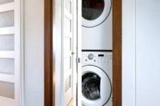 17 a built-in washer and dryer right in the wall, hidden with a floor to ceiling mirror is a very smart and modern idea
