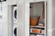 19 a mini laundry hidden in a closet behind semi sheer doors is a great way to keep it neat and not always seen