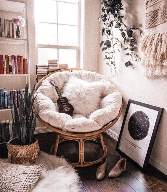 a rattan papasan chair with soft upholstery and a pillow is amazing not only for reading but also for many other things