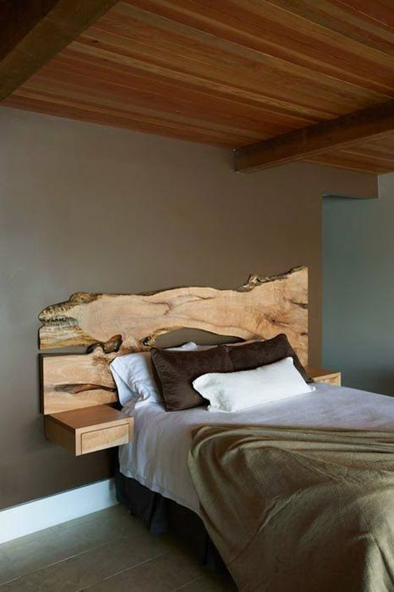a live edge wooden headboard with little floating nightstands adds a natural feel to the space