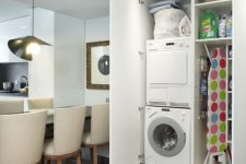 21 a mini laundry hidden right in the dining space in a large wardrobe is a great idea to try