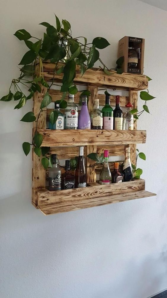a light stained wine rack of pallet wood features enough space for bottles