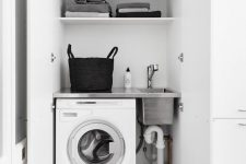 23 a small laundry built into a sleek white cabinet is a great idea – you can place this cabinet anywhere