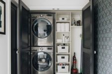 24 a small laundry built into an awkward nook of your home and hidden with black shutter doors