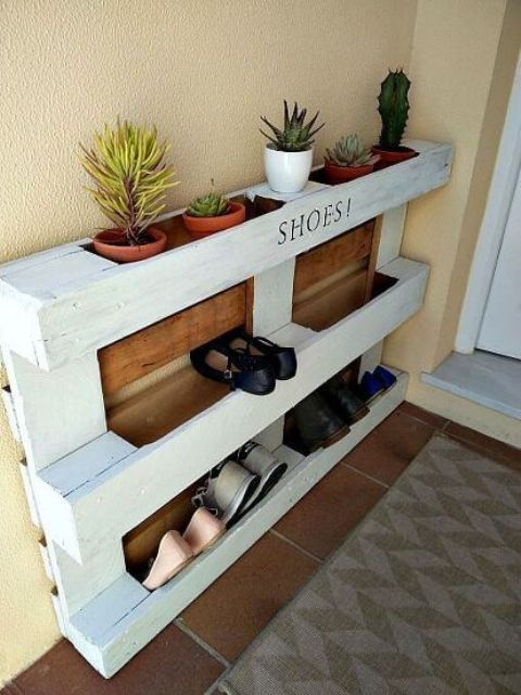 an easy pallet shoe rack with stained parts features shoe storage and storage for pots with succulents